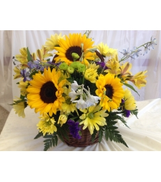 sunflowers with seasonal flowers basket